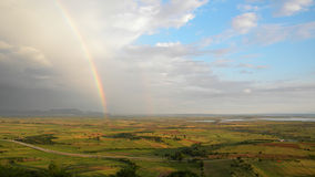 Rainbow. A beautiful rainbow in a classical European plain rural landscape Royalty Free Stock Photography