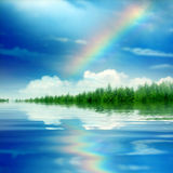 Rainbow. With the water reflection Royalty Free Stock Photography