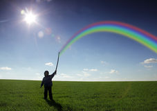 Rainbow. In children hand outdoors Royalty Free Stock Photos