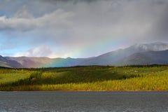 Rainbow. In the mountain ridge Big Anngachag Stock Image