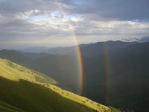 Rainbow. In the western alps after thunderstorm Royalty Free Stock Photography