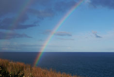 Rainbow. Double rainbow over sea shore Royalty Free Stock Photo