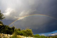 Rainbow. Suggestive Rainbow of winter landscape in sicilian hinterland royalty free stock images