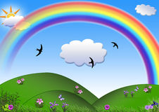 The Rainbow. Spring/summer picture - the Rainbow above a blossoming meadow Stock Photography