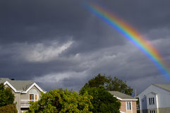 Rainbow. Over a typical American town after a thunderstorm Royalty Free Stock Photo