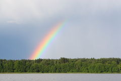 Rainbow. On lake after a rain Royalty Free Stock Photography