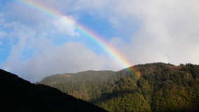Rainbow. Over the mountains,Tibet,China Royalty Free Stock Photo