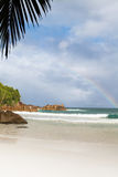 Rainbow. Seychelles seascape. Granite stones and ocean. Anse Takamaka Royalty Free Stock Photo