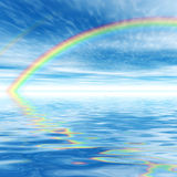 Rainbow. On the aquamarine water Royalty Free Stock Images