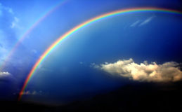 Rainbow. Two rainbows with dark blue sky Royalty Free Stock Photos