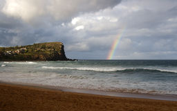 Rainbow. In the ocean Stock Images