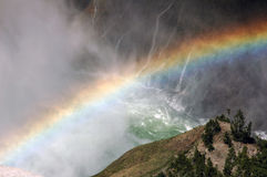 Rainbow. A rainbow coming out of a waterfall at Grand Tetons National Park in Wyoming Stock Image