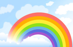 Rainbow. On blue cloudy background Stock Images