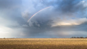 Rainbow on an abandoned field Royalty Free Stock Photography