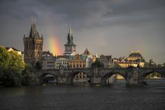 Rainbow above Charles bridge stock image