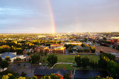 Rainbow above city edmonton Stock Photos