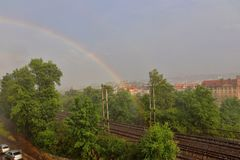 A rainbow above the city royalty free stock image
