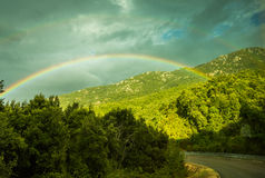 Rainbow above Corsica. Ranbow above Corsica road, forest. Rainy wetter royalty free stock photos