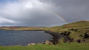 Rainbow above Duntulm Bay and castle on the Isle of Skye - Scotland.  stock video footage