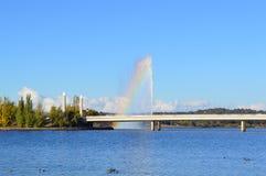 Rainbow above the fountain bridge lake views Stock Image