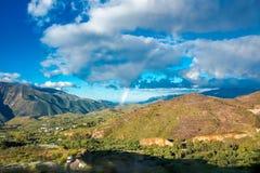 A rainbow above Granada. Photograph of a rainbow above Granada, Spain Stock Photography