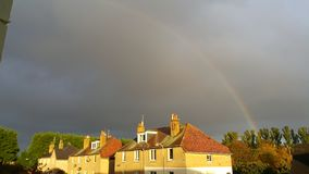 Rainbow above houses in St Andrews Royalty Free Stock Photos