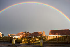 Rainbow Above Housing Estate Stock Images