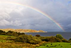 Rainbow above the lake Stock Images