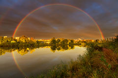 Rainbow above lake Stock Image