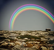 Rainbow above a lonly house Royalty Free Stock Image