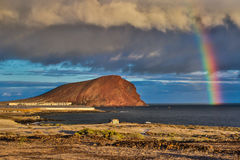 The Rainbow above Montana roja, Tenerife, Canary Islands. The Rainbow above Montana roja with evening sunlight, Tenerife, Canary Islands stock images
