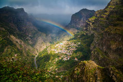 Rainbow Above Mountain Village Royalty Free Stock Photo