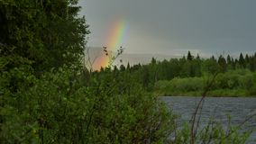 Rainbow above mountains. Giant rainbow above ural mountains stock footage