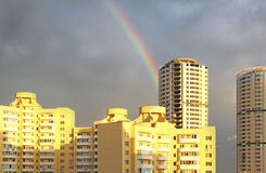 Rainbow above new houses Stock Image