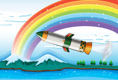 A rainbow above the ocean and an aircraft Stock Photo
