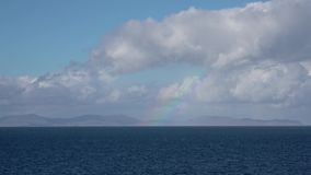 Rainbow above the outer hebrides seen from Duntulm on the Isle of Skye, Scotland.  stock video footage