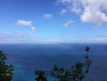 Rainbow above Pacific Ocean - View from Kalalau Trail on Na Pali Coast on Kauai Island, Hawaii. Stock Photos