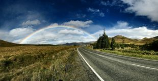 Rainbow above the Road Royalty Free Stock Image