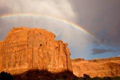 Rainbow Above Sandstone Cliff. Rainbow arches above massive sandstone cliffs stock photos