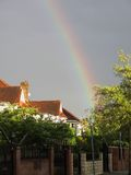 Rainbow above suburban houses Stock Image