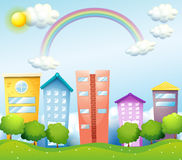 A rainbow above the tall buildings Stock Photo
