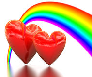 Rainbow above a two bound hearts Stock Photo
