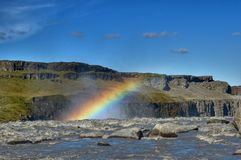 Rainbow above waterfall Stock Photos