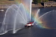 Rainbow across fire boat in Portland, Oregon. Royalty Free Stock Photography