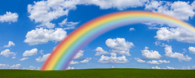 Rainbow Across Green Field Stock Photo
