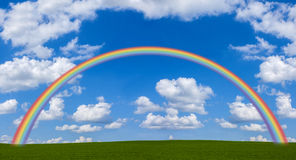 Rainbow Across Green Field Royalty Free Stock Photo