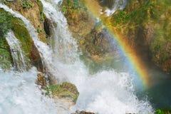 Rainbow across Waterfall Stock Image