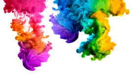 Rainbow of Acrylic Ink in Water. Color Explosion. Ink in water isolated on white background. Rainbow of colors Stock Photos
