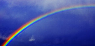 Rainbow Against Blue Sky Royalty Free Stock Images