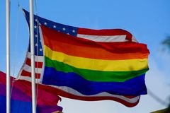 Rainbow & American flags. Rainbow and American flags at half-staff in San Diego, California, after the Orlando mass shooting royalty free stock photography